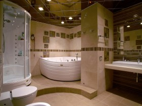 The interior of a large bathroom in dark colors