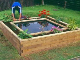The idea of the pond with flower bed