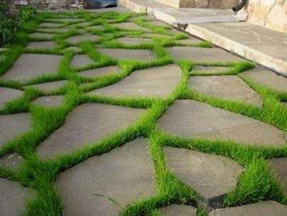 Природный и искусственный камень в роли элемента садового декора