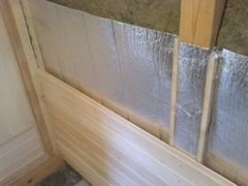 Vapor barrier and decorative wall bath paneling