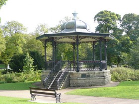A gazebo made of stone and metal