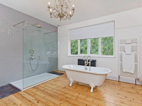 The bathroom is larger with elements of Scandinavian style
