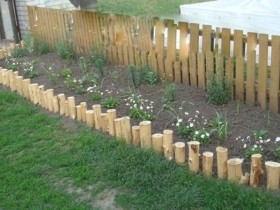 Homemade wooden border for flower beds