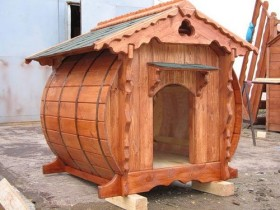 Carved dog house from a barrel