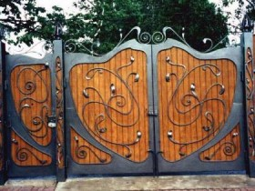 Wooden gates with elements of forging