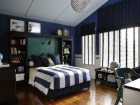 Children's room for a teenage boy in dark colors