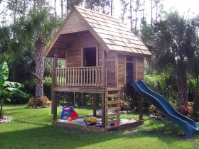 A Playhouse with sandpit and slide