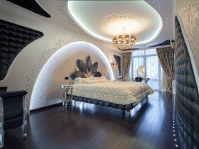 Modern bedroom with decorative lighting