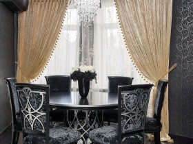Luxury dining room with dark furniture