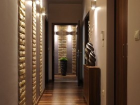 The combination of materials in the finishing of a long hallway