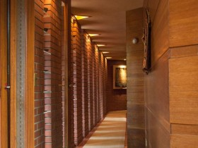 A long hallway in a brick and wood finish