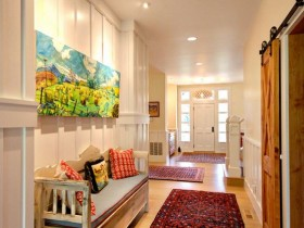 Bright interior hallway with bench