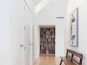 White entrance hall with sloping ceiling
