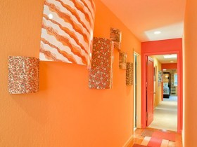 A long narrow hallway in an orange color