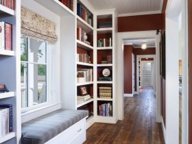 The idea of the design of the long hallway with a book locker and a sofa