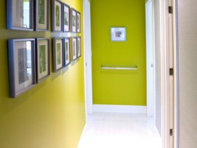 A long narrow hallway with a bright green color