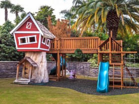Children's tree house with slide and swings