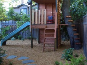 Children's tree house with a slide