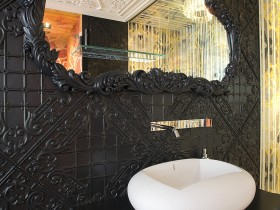 The design of white washbasin in front of a black wall