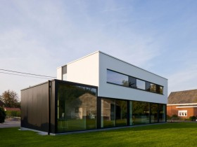 The façade is two-storey house in the style of hi-tech