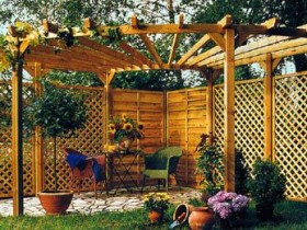 Example of a wooden pergola for a suburban area