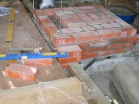 The brickwork on the Foundation under the stove