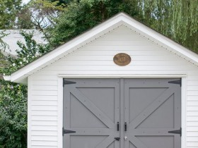 White garage with grey gate