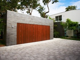 Brick garage with wooden gate in a modern style