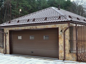 Stone garage with roller gate