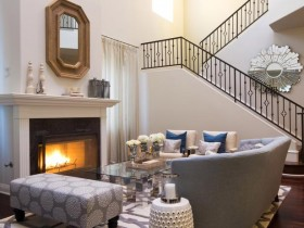 A fireplace in the living room design