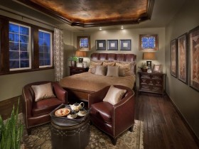 Dark brown bedroom with leather furniture