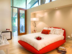 Bright bedroom with red bed