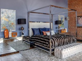 Bedroom with mirrored closet and brick wall