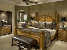 Bedroom with carved wooden bed in dark hues