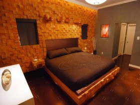Bedroom with a wall and a bed from lumber