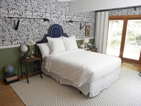Bright bedroom with creative Wallpaper