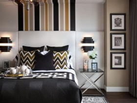 Beautiful bedroom with stripes as highlights of the design