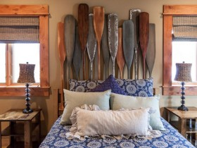 Bedroom in a nautical style with a headboard in the form of oars