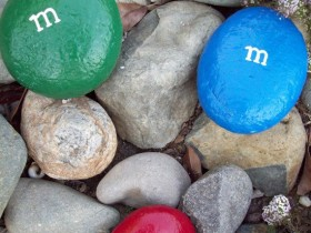 Painted rocks in the style of M&M's
