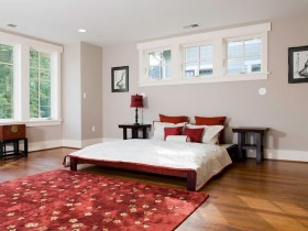 Bright bedroom in the Chinese style with bright red carpet