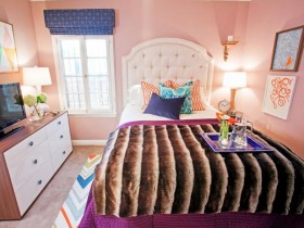 Pink bedroom with blue accessories