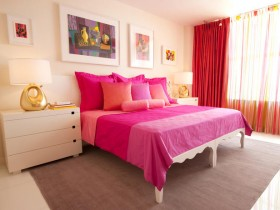 White room with pink bed