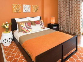 Bright bedroom in orange color