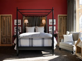 Bedroom in red with canopy bed