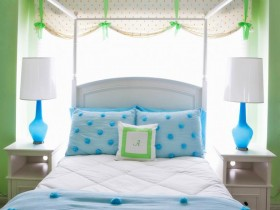 White bedroom with green and blue accessories