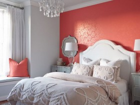 White bedroom with one pink wall