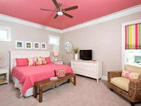 White bedroom with pink ceiling and bed linen