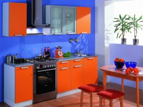 Kitchen with blue walls and red furniture