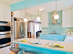 Large bright kitchen with turquoise furniture