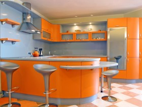 Bright kitchen with orange furniture